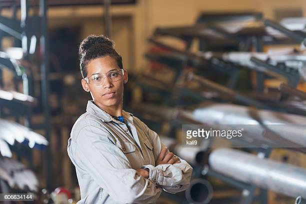 Young woman working in factory