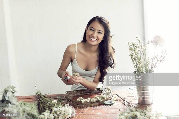 young woman working in flowershop