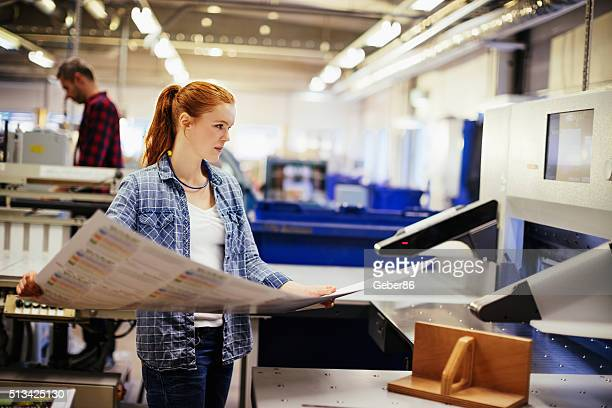 Young woman working in printing factory