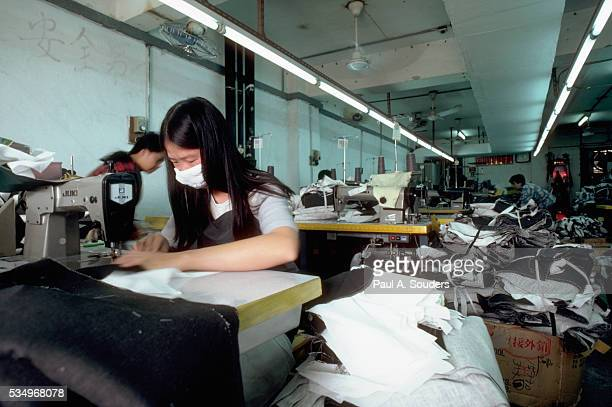 Young Woman Working in Sweatshop