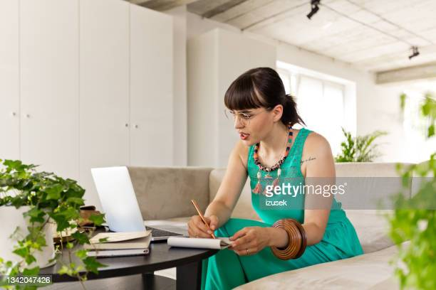 young woman working in the eco-friendly green office - izusek stock pictures, royalty-free photos & images