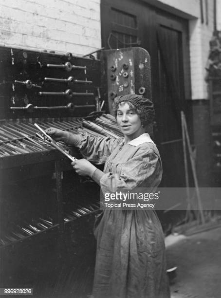 Young woman working in the engineering shop of the London General Omnibus Company during the World War I labour shortage, London, 27th September 1917.