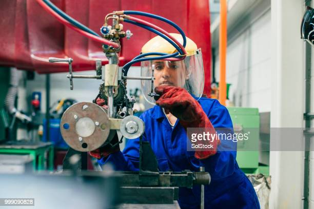 young woman working in the engineering workshop - stem stock photos and pictures