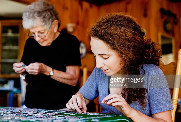 Young woman working on a jigsaw puzzle