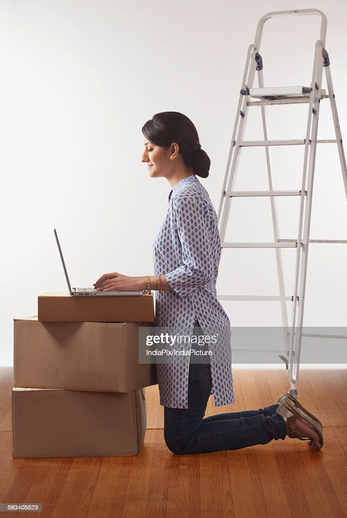 Young woman working on a laptop : Stock Photo