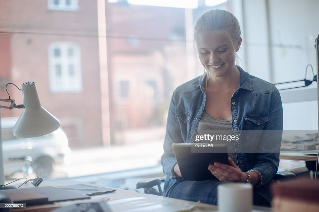 Young woman working on a project : Stock Photo