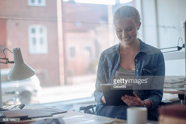 young woman working on a project - nordic countries stock pictures, royalty-free photos & images