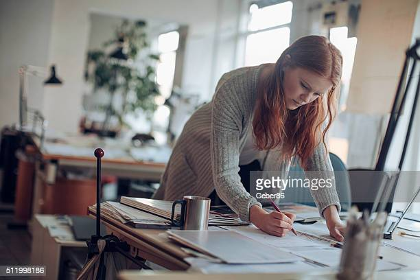 young woman working on a project - architect stockfoto's en -beelden