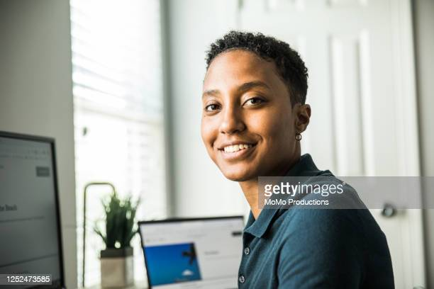 young woman working on desktop computer at home - authenticity stock pictures, royalty-free photos & images