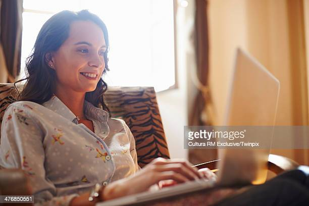 Young woman working on laptop at home