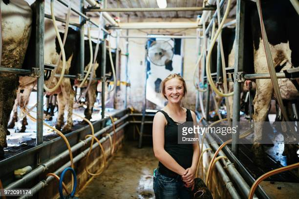young woman working on the dairy farm in usa - milk pack stock photos and pictures