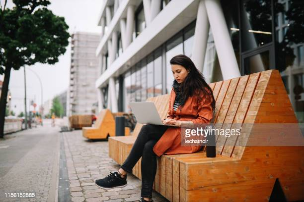 young woman working on the go in berlin - bench stock pictures, royalty-free photos & images