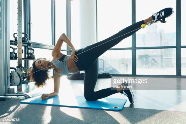 Young woman working out in gym, using gym equipment