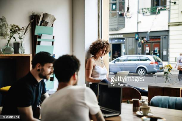 young woman working quietly in cafe - digital native stock pictures, royalty-free photos & images