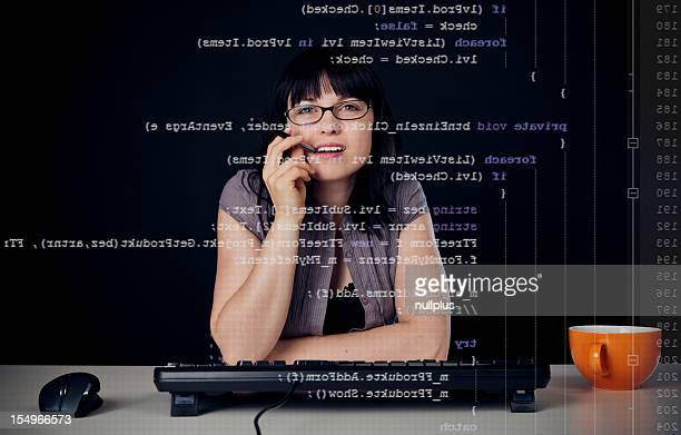 young woman writing a c# program