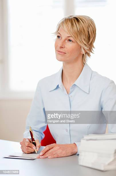 young woman writing cards - thinking of you card stock pictures, royalty-free photos & images