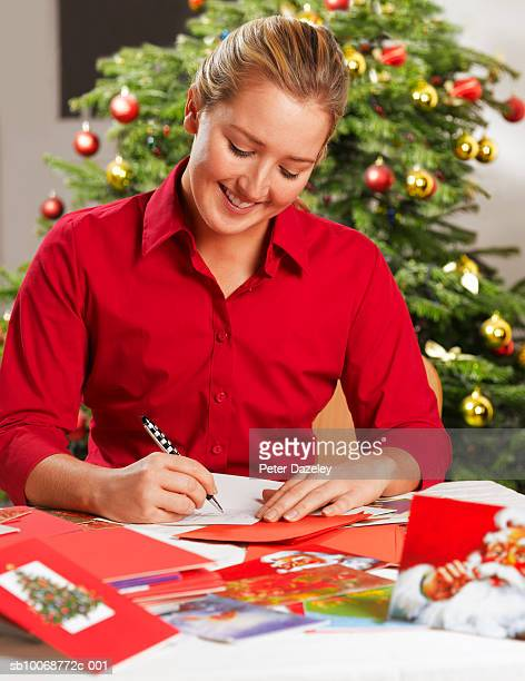 Young woman writing Christmas cards