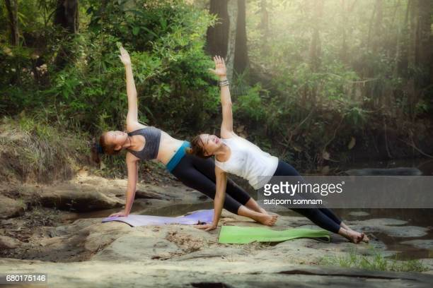 yoga young woman yoga training with trainer - hot body girls stock photos and pictures