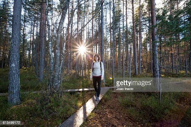 Young womand exploring Holma-Saarijarvi, Nuuksio National Park, Finland