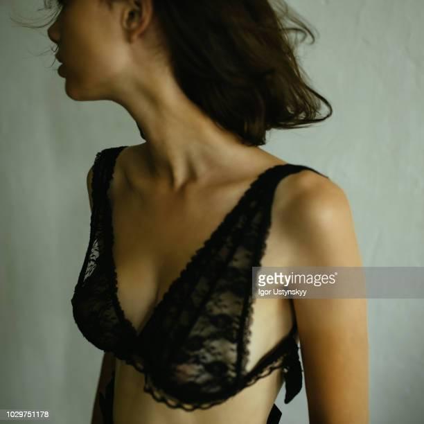young woman's breast through bra - frau brust erotisch stock-fotos und bilder