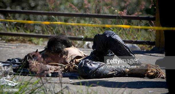 A young woman's dead body showing signs of torture is recovered from a garbage dump in zone 16 of Guatemala City Currently less then 1% of femicide...