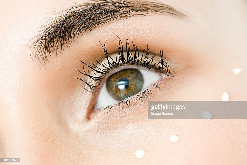 Young woman's eye, close up : Stock Photo