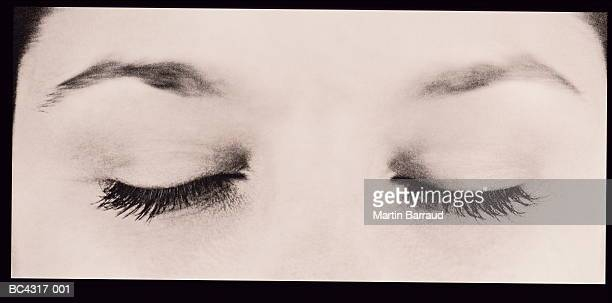 Young woman's eyes, closed, close-up (toned B&W)
