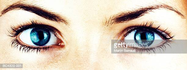 young woman's eyes, close-up (cross-processed) - pair stock pictures, royalty-free photos & images