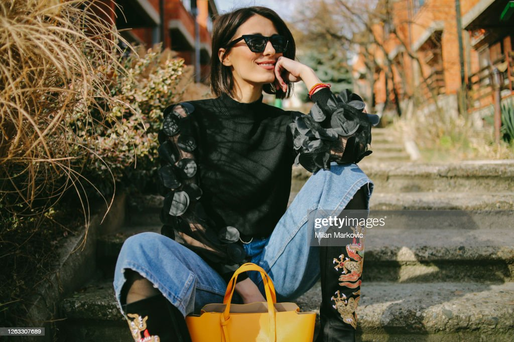 Young woman's fashion style - Young pretty fashioned girl : Stock Photo