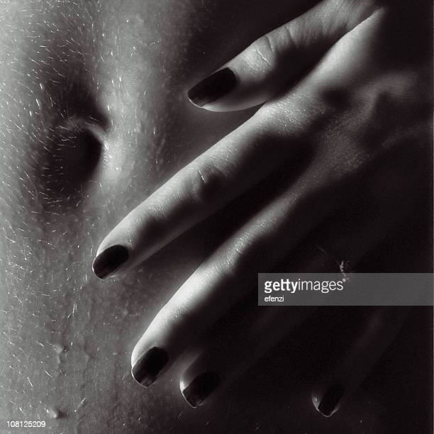 young woman's hand on stomach near belly button - sensual massage stock photos and pictures