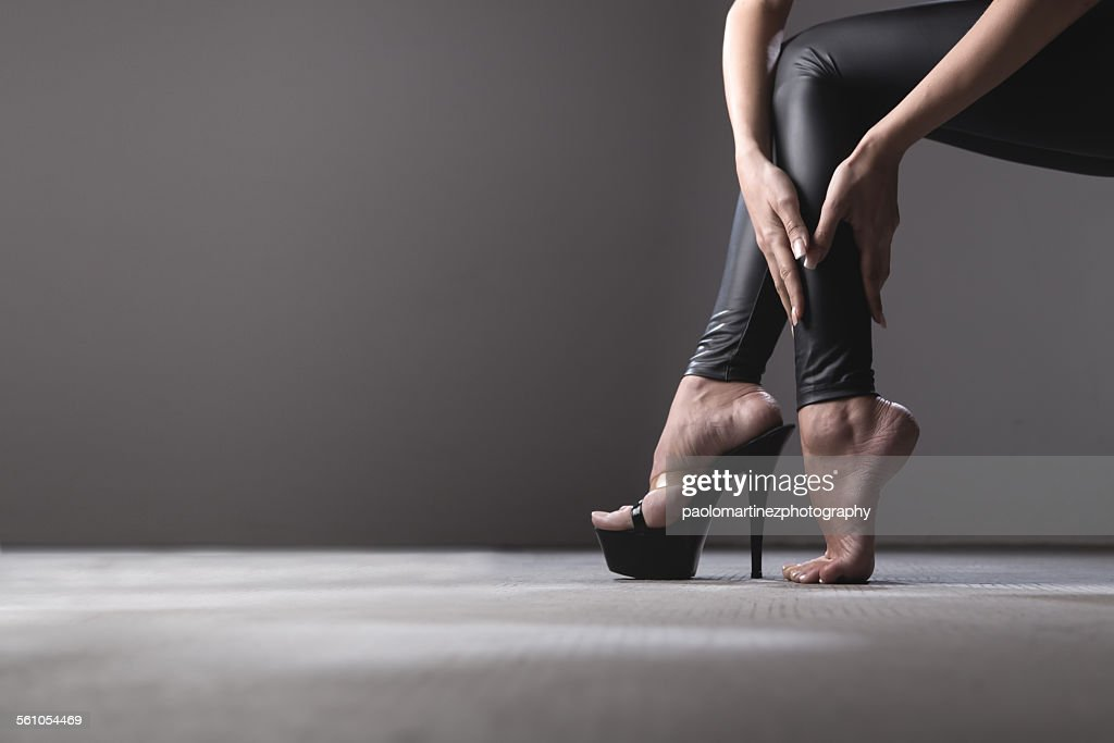 Young woman's legs and high heel : Stock Photo