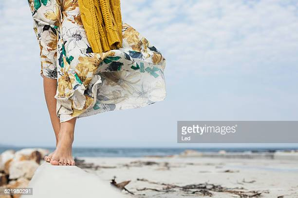 young womans legs walking along cement block on beach, cape town, western cape, south africa - ankle length stock pictures, royalty-free photos & images