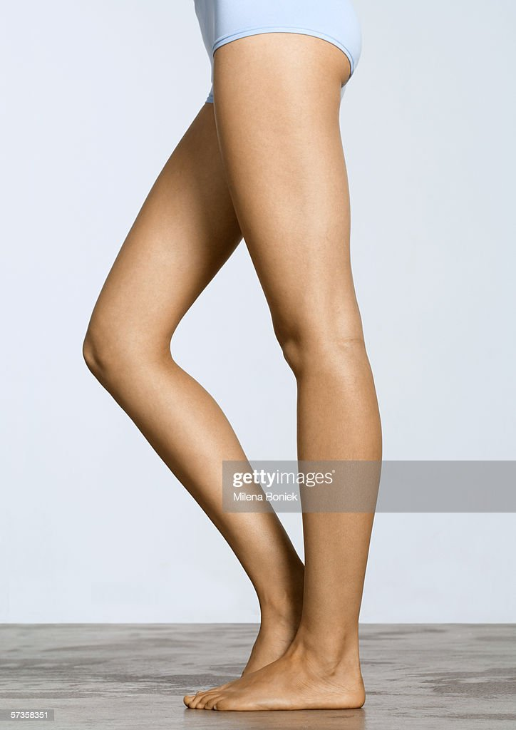 Young woman's legs, with one knee bent : Stock Photo