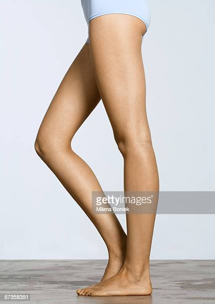 young woman's legs, with one knee bent - leg stock pictures, royalty-free photos & images