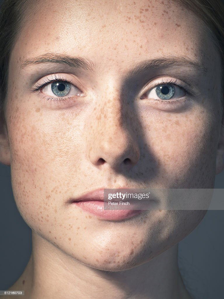 Young woman's portrait with freckles : Stock Photo