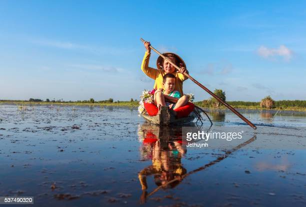 Young women and her son rowing boat at pond