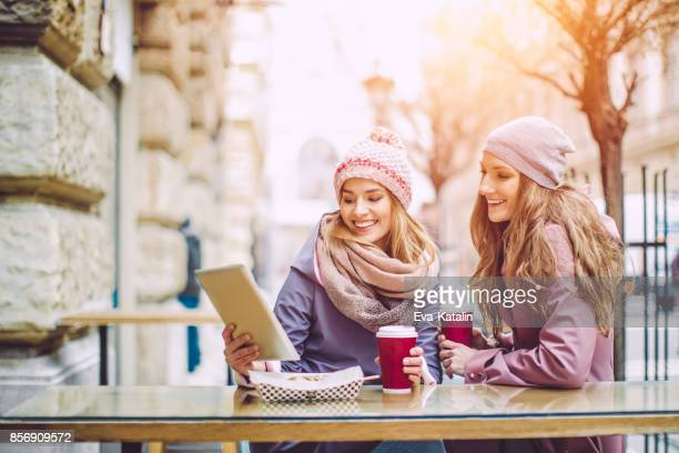 Young women are having fun in a coffee shop