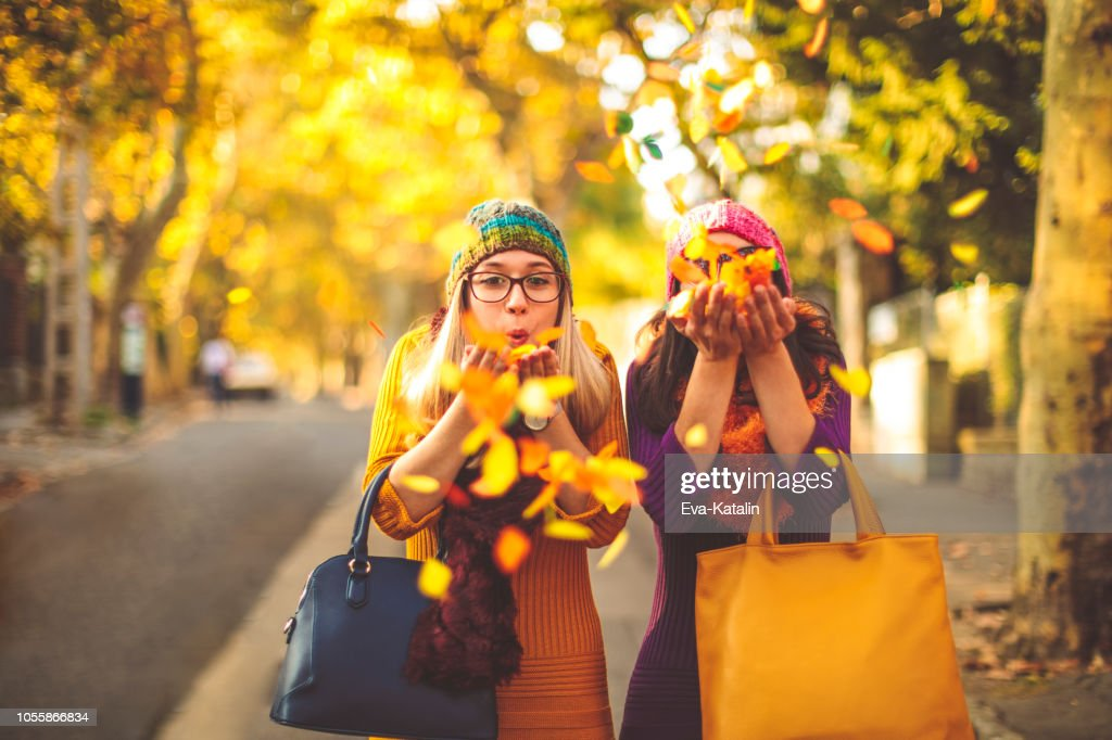 Young women are having fun in the city - autumn mood : Stock Photo