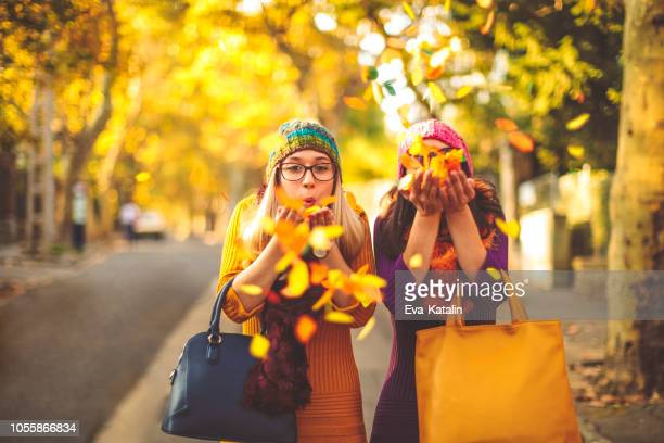 young women are having fun in the city - autumn mood - autumn stock pictures, royalty-free photos & images