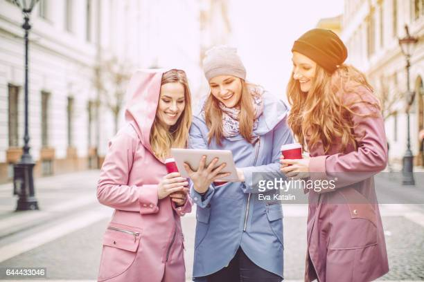Young women are having fun in the city