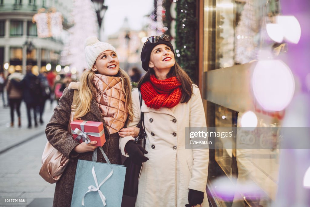 Young women are shopping together for Christmas : Stock Photo