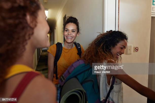 young women arriving to room with bunk beds, at youth hostel - open backpack stock pictures, royalty-free photos & images
