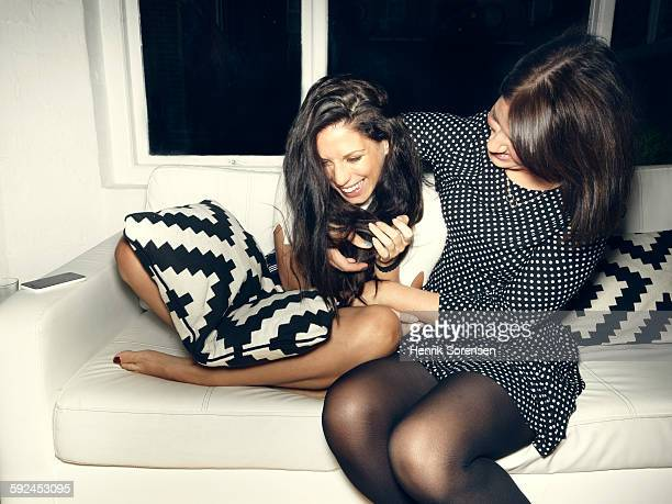 2 young women at a party