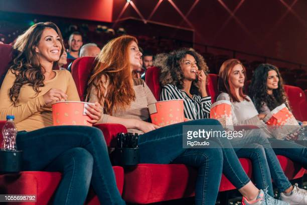 young women at cinema - comedy film stock photos and pictures