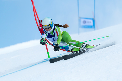 Young Women at Giant Slalom Against the Blue Sky 1044422672