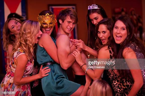 young women at hen party with male stripper - strip stock-fotos und bilder