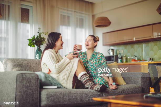young women at home - bathrobe stock pictures, royalty-free photos & images