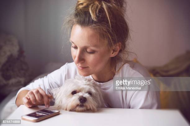 Young women at home with her dog