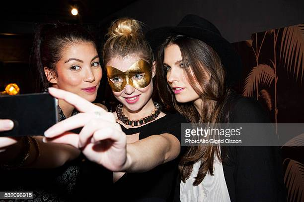 Young women at night club taking selfie