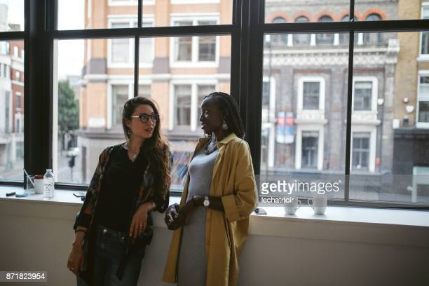 young women at the coffee break in the apartment - gossip stock pictures, royalty-free photos & images